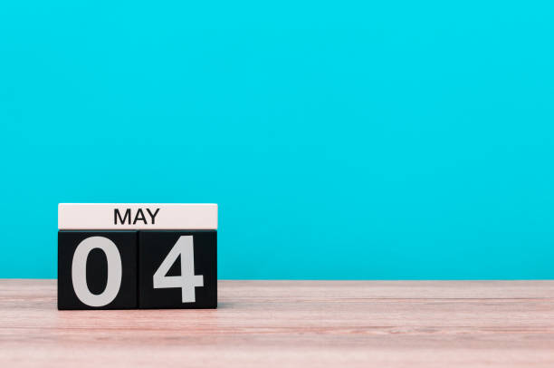 May 4th. Day 4 of month, calendar on turquoise background. Spring time, empty space for text May 4th. Day 4 of month, calendar on turquoise background. Spring time, empty space for text. day 4 stock pictures, royalty-free photos & images