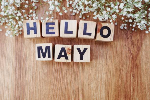 may alphabet letters on wooden background stock photo