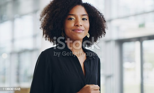 Cropped shot of a confident young businesswoman walking through a modern office