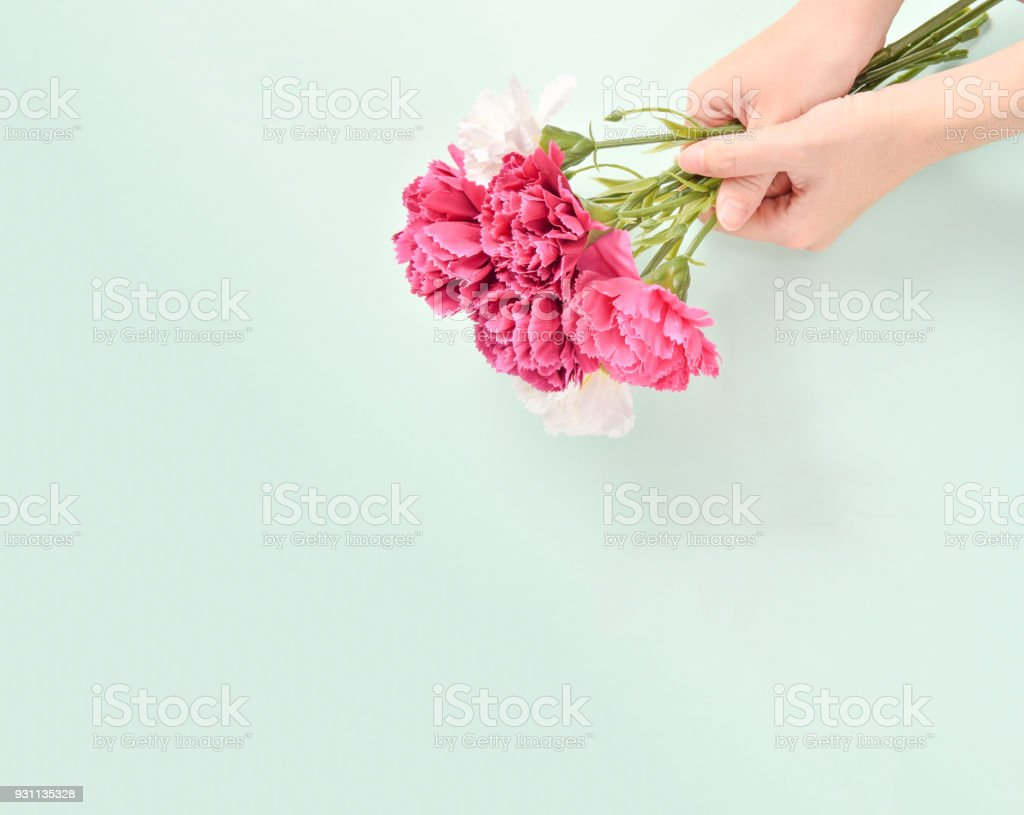May mothers day carnation bunch of flowers bouquet holded by mothers may mothers day carnation bunch of flowers bouquet holded by mothers handtop view izmirmasajfo
