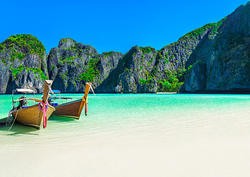 Maya Bay beach with two longtail boats, Ko Phi Phi Leh Island, Thailand
