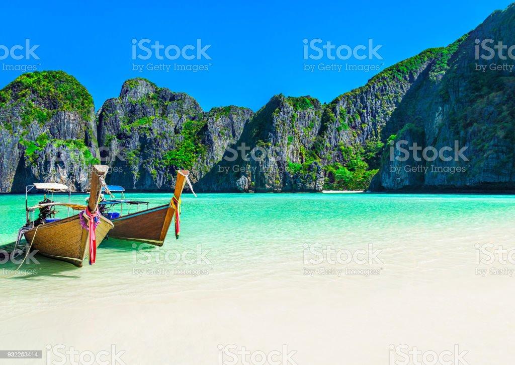 Maya Bay beach with two longtail boats, Ko Phi Phi Leh Island, Thailand stock photo