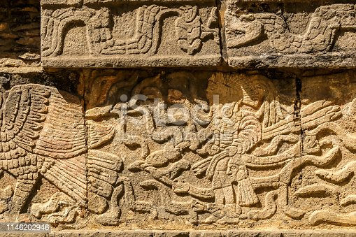 Mayan figures carved on stone wall at Chichen Itza, Yucatan Peninsula, Mexico, America