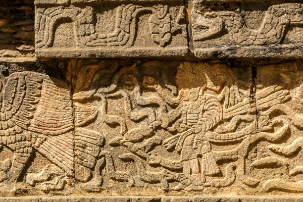 Mayan figures carved on stone wall at Chichen Itza, Yucatan Peninsula, Mexico stock photo
