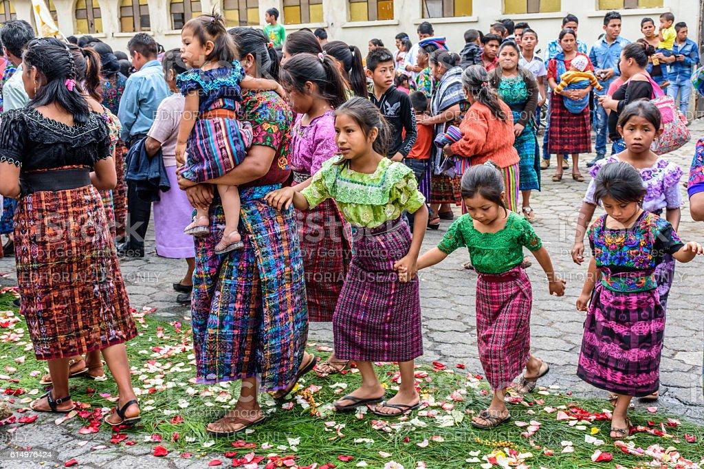 Mayan girls on Corpus Christi carpet, Parramos, Guatemala stock photo