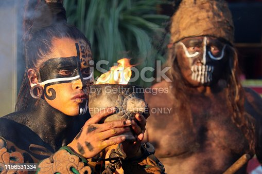 istock Mayan priest and warrior of Maya during ancient fire ritual 1156531334
