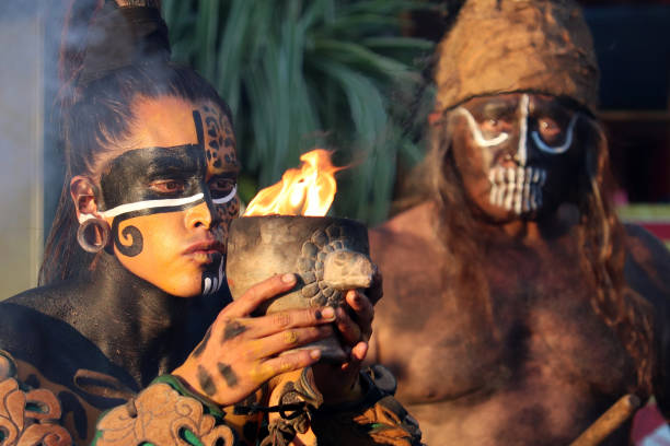 mayan priest and warrior of maya during ancient fire ritual - warrior person stock pictures, royalty-free photos & images