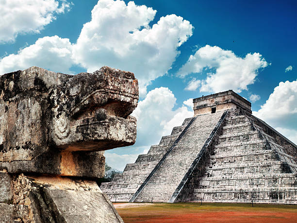 Mayan pyramid Chichen-Itza with Sacred Snake on foreground stock photo