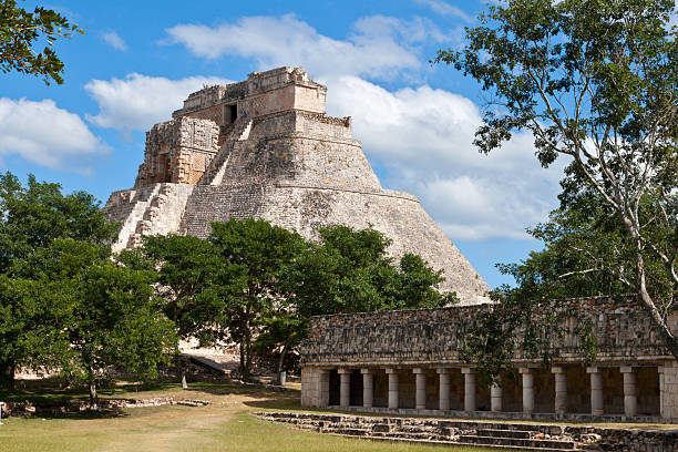 mayan pyramid (pyramid of the magician, adivino) in uxmal, mexic - uxmal stock photos and pictures