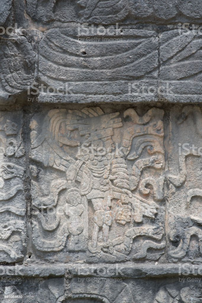 Mayan warrior with severed head stone carving at the Mayan ruins at Chichen Itza stock photo