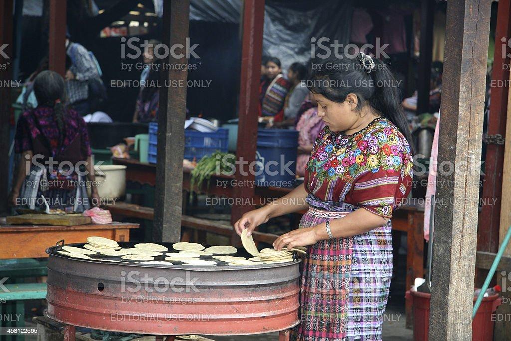 Mayan woman making tortillas on the market in Chichicastenango, Guatemala stock photo