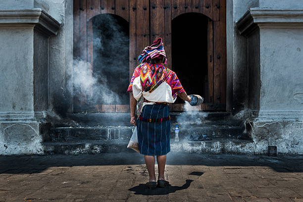 Mayan woman performing a ritual in Chichicastenango stock photo