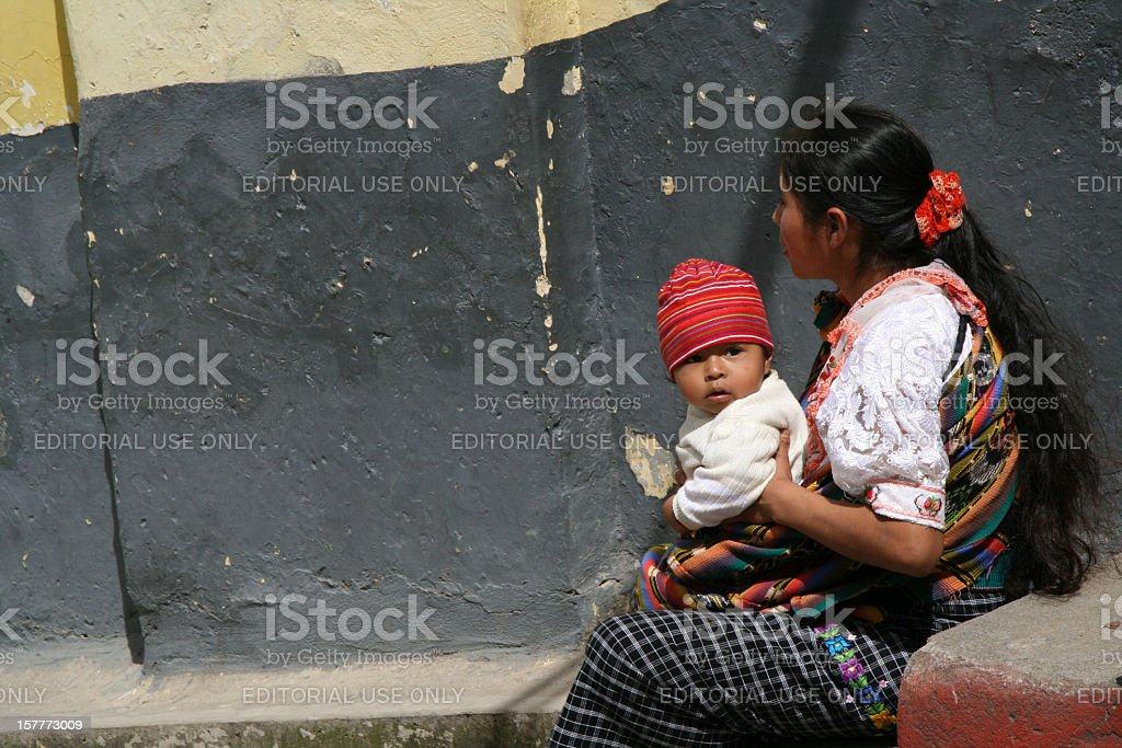 Mayan woman resting with her little son in Chichicastenango, Guatemala stock photo