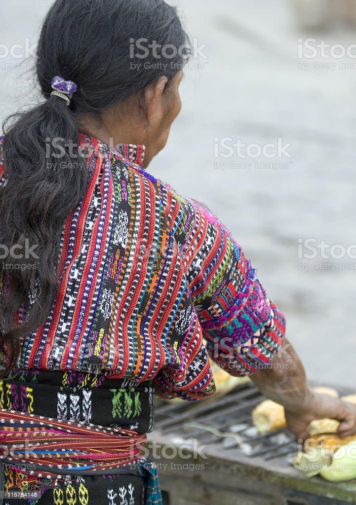 Mayan woman roasting corn, Lake Atitllan, Guatemala stock photo
