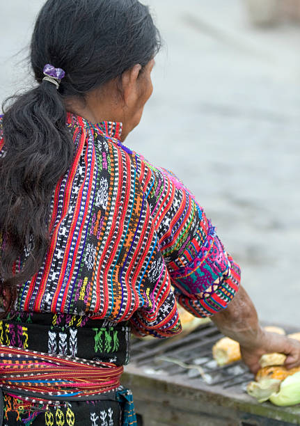 Mayan woman roasting corn, Lake Atitllan, Guatemala stock photo