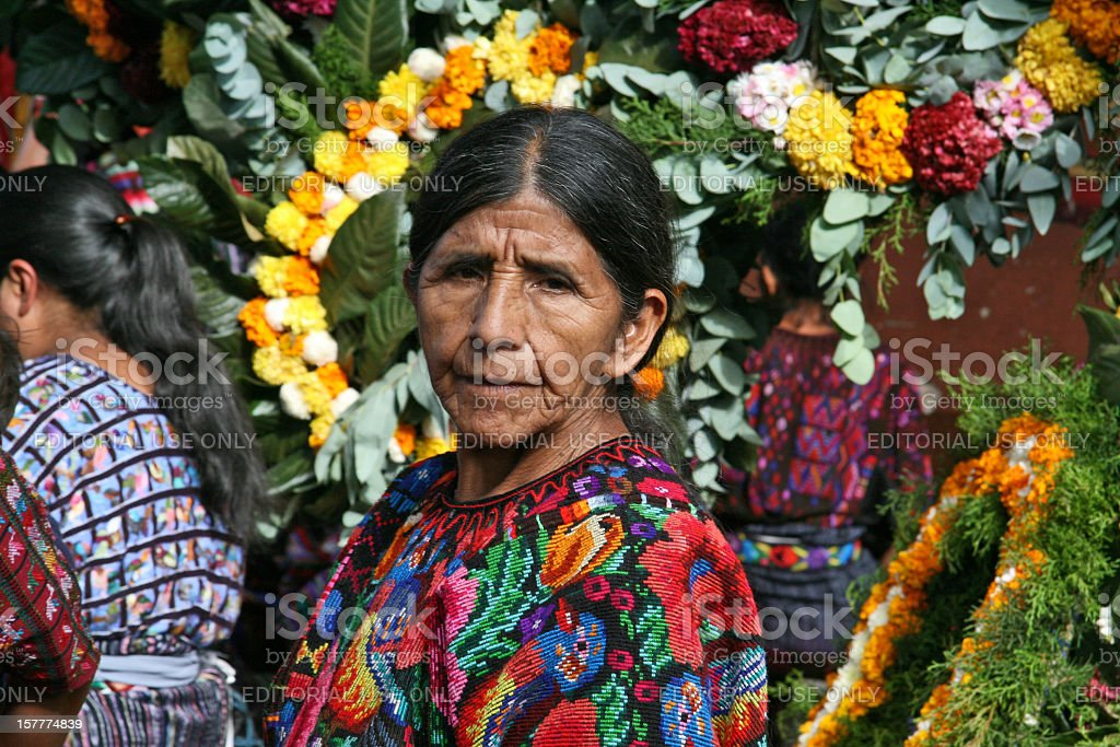 Mayan woman wearing traditional, handwoven and colourful clothing. stock photo