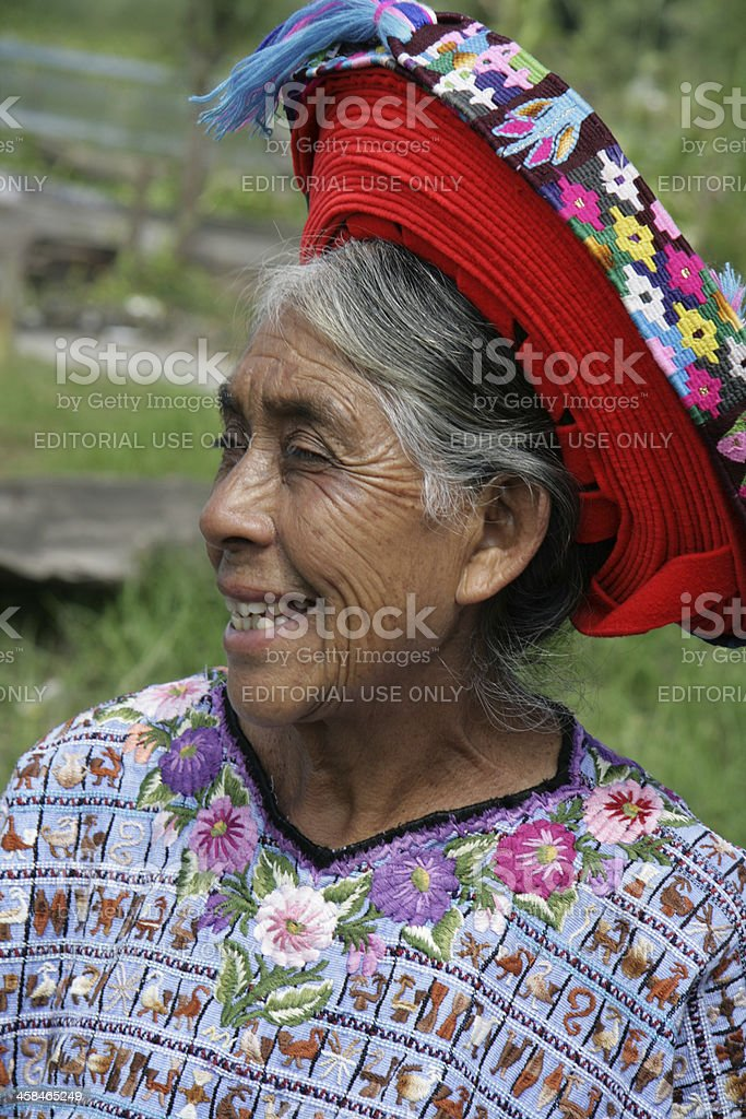 Mayan woman wearing traditional hat and blouse in Guatemala stock photo