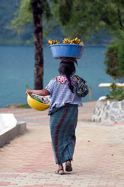 Mayan Woman with fruit, Lake Atitlan Guatemala stock photo