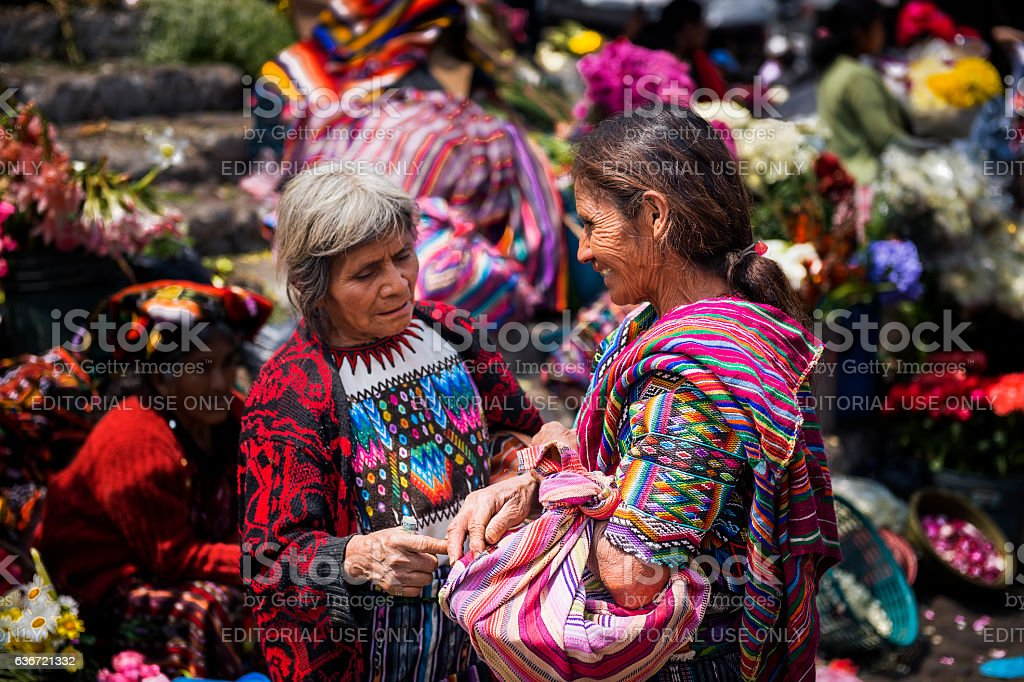 Mayan women in a market in Chichicastenango, Guatemala stock photo