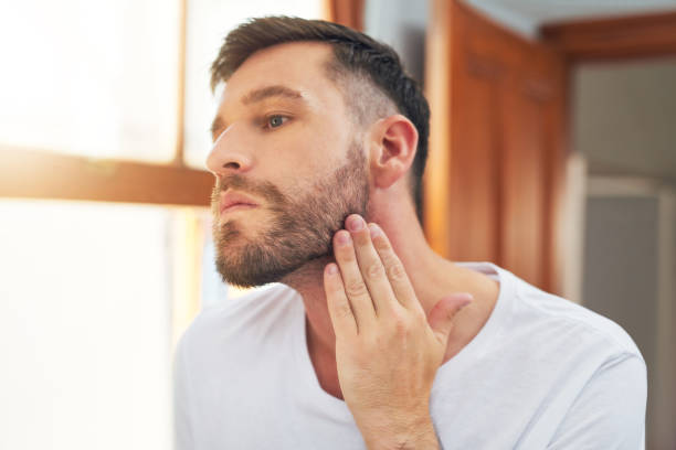 Maybe I should shave it all off Shot of a handsome young man going through his morning routine at home hair stubble stock pictures, royalty-free photos & images