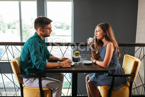 Shot of a couple having a conversation over coffee at the restaurant
