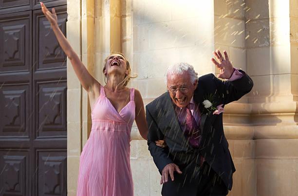 may-december wedding stock photo