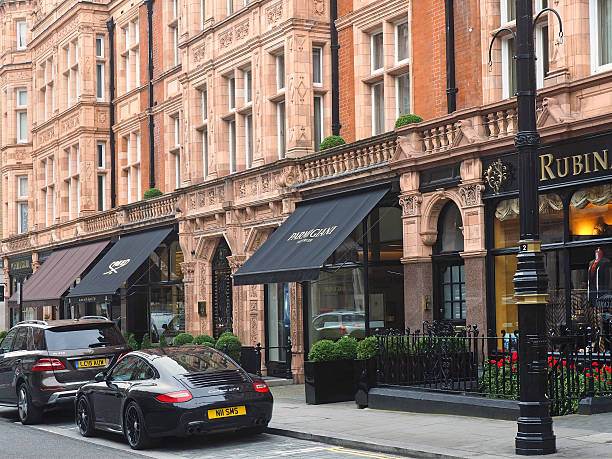 Mayfair shops, London London, England - September 27, 2016:  Mayfair is noted for its elegant architecture and upscale shops, as well as the expensive cars driven by its patrons. mayfair stock pictures, royalty-free photos & images