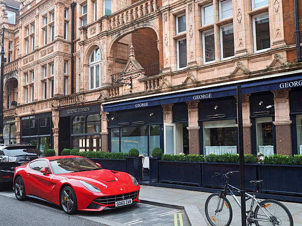 Mayfair shops, Mount Street London, England - September 27, 2016:  Mayfair is noted for its elegant architecture and upscale shops, as well as the expensive cars driven by its patrons. mayfair stock pictures, royalty-free photos & images