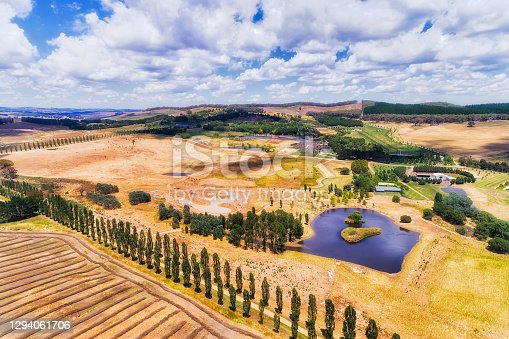 Cultivated farmlands in agriculture Central tablelands of NSW, Australia near Oberon Mayfield and local Mayfield garden park.
