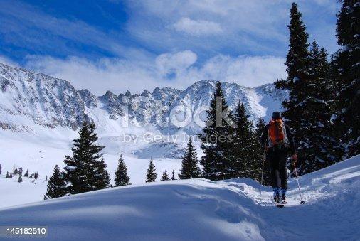 tour skier headed up mayflower gulch, summit county, Colorado, USA