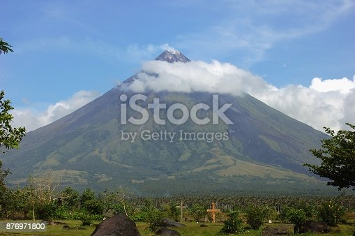 Mayon volcano perfect shape viewed from the ruins of Cagsawa, site of a hundred years ago strong eruption that destroyed a church and killed many people. Albay, Philippines