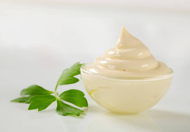 Mayonnaise in a glass bowl stock photo