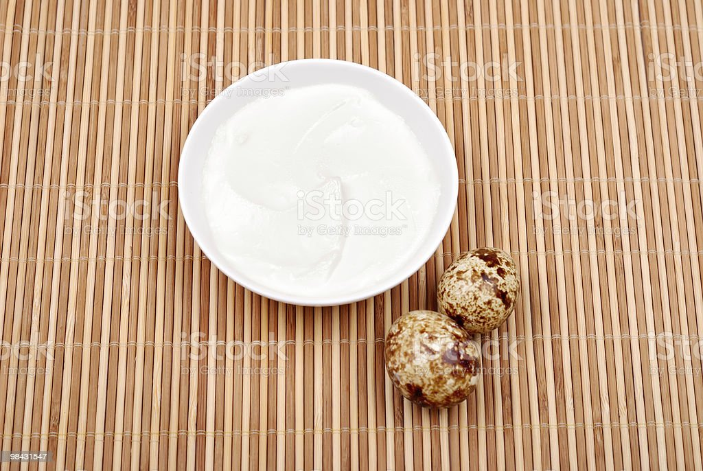 Mayonnaise in a saucer and quail eggs royalty-free stock photo