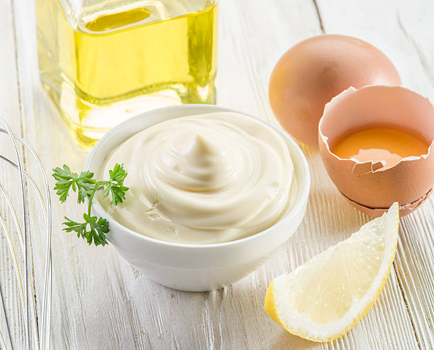 Mayonnaise ingredients and the sauce. stock photo