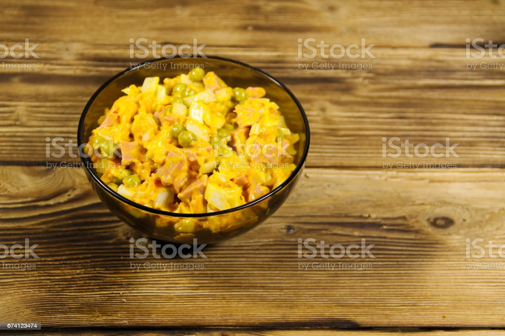 Mayonnaise salad with sausage, green pea, carrot and onion royalty-free stock photo