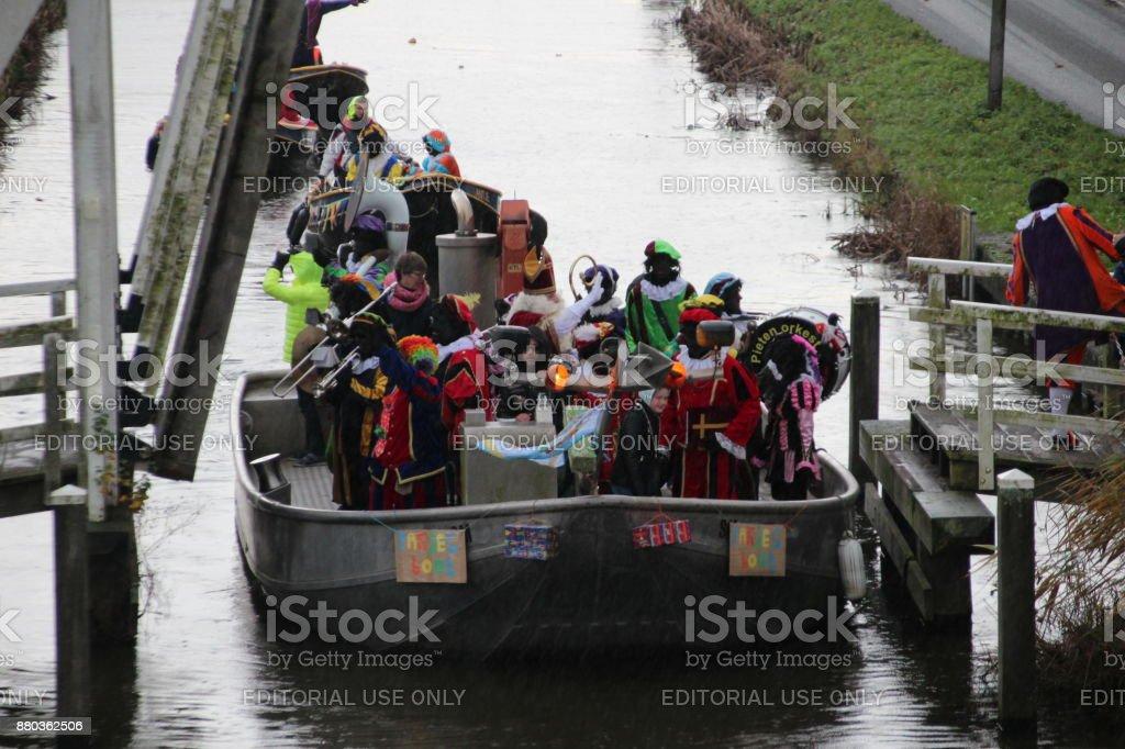Mayor Gert Jan Kats welcomes Sinterklaas during the arrival of sinterklaas in the ring canal in Nieuwerkerk aan den IJssel stock photo
