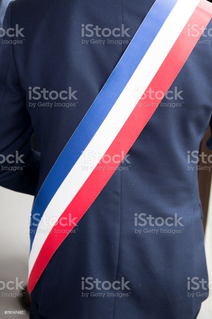 Mayor of French town with French tricolour flag mayoral sash stock photo