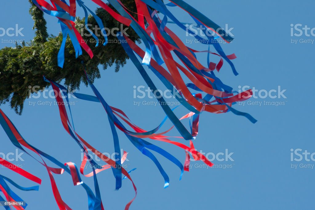 maypole with colorful ribbons in south german countryside royalty-free stock photo