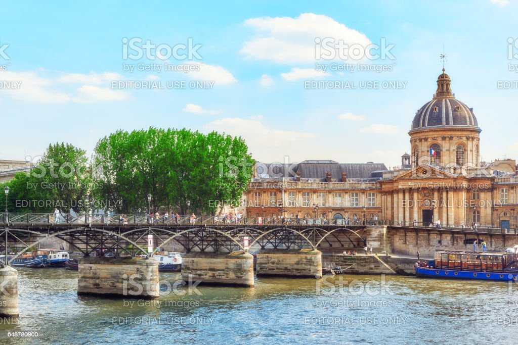 Mazarin Library (Bibliotheque Mazarine) and  Bridge of the Arts ( Pont des Arts) in Paris. - Photo