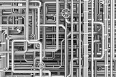 istock Maze of metal pipes background 584217158