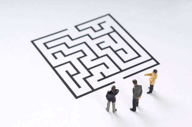 maze - figurine stock photos and pictures