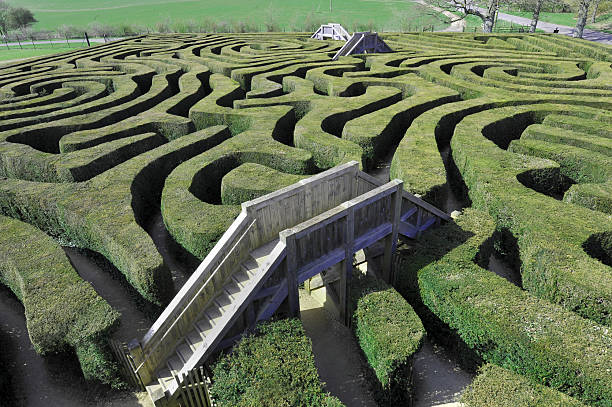 maze with bridges - maze stock photos and pictures