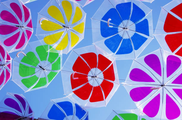 mbrellas coloring the sky stock photo