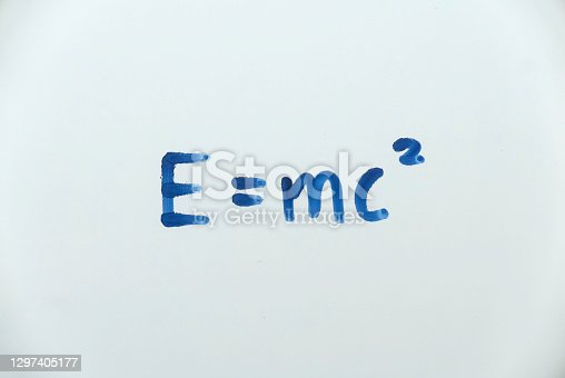 E=mc² written on a white board. The famous equation of Energy equals mass times the speed of light squared by Albert Einstein.