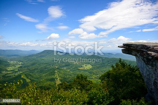The view from McAfee Knob on Catawba Mountain, near Roanoke, Virginia. It is one of the most popular overlooks on the Appalachian Trail and is situated at an elevation is 3,171 feet.