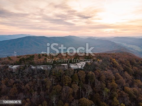 Aerial photo of McAfee Knob, described as the most iconic location on the Appalachian Trail, near Roanoke, VA, taken at sunset on a fall evening.