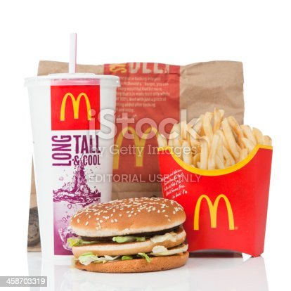 Newcastle upon Tyne, England - March 5, 2011: McDonald\'s Big Mac value meal isolated on a white background.  A Big Mac, fries and a coke sitting on a reflective surface.