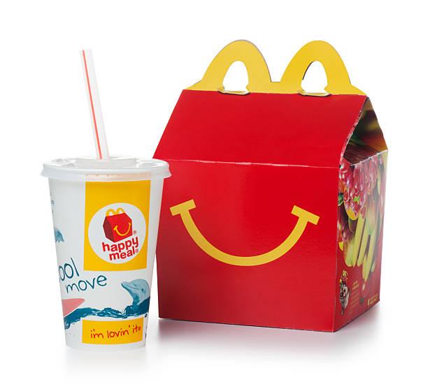 mcdonalds счастливой едой на белом - mcdonalds стоковые фото и изображения