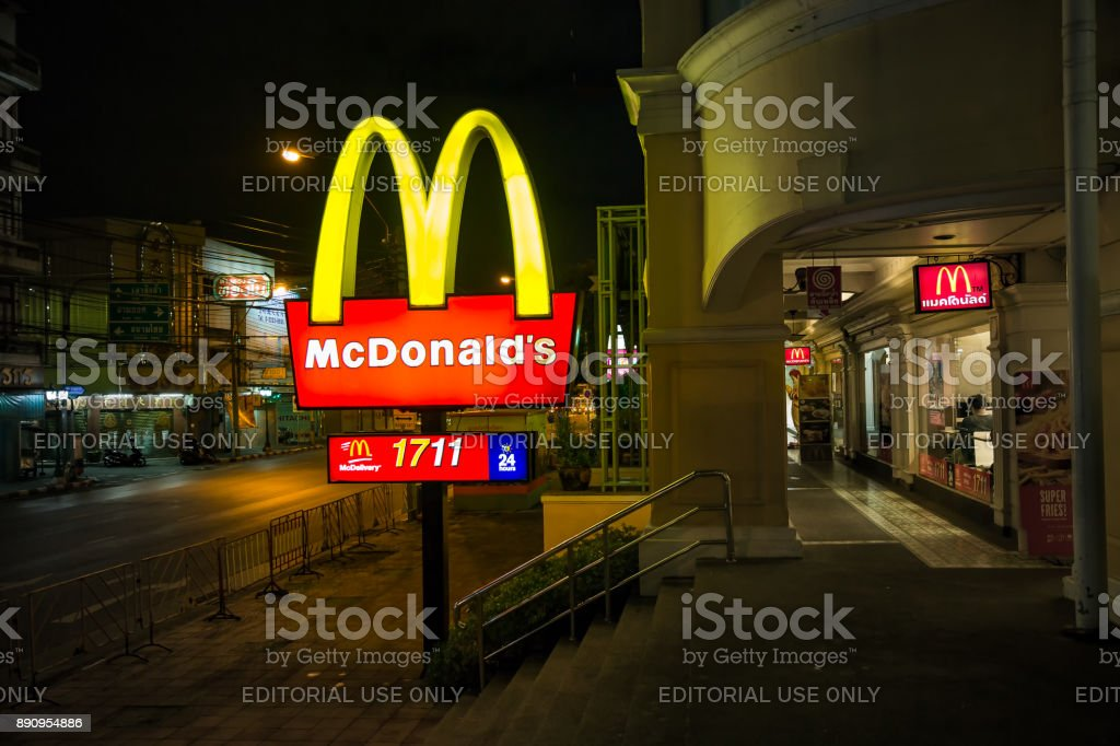 McDonald's logo lightbox at night and telephone number delivery 24 hours. stock photo