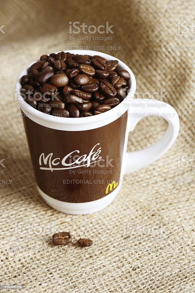 McDonalds McCafé Cup filled with coffee beans stock photo